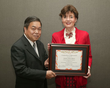 Board Member Dr. Long Pham with Justice Eileen Moore, 4th District Court of Appeals